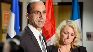 Public Safety Minister Steven Blaney and Lise Theriault Quebec's Public Security Minister and Deputy Premier, address reporters at a news conference in Saint-Jean-sur-Richelieu, Que. Tuesday Oct. 21, 2014. (Paul Chiasson / THE CANADIAN PRESS)