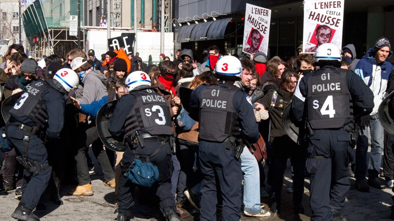Students protesting rising tuition costs clash with police in Montreal, Wednesday, March 7, 2012. (Marie-Esperance Cerda / THE CANADIAN PRESS)