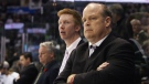 London Knights General Manager Mark Hunter, right, looks on during a break in second period action against the Edmonton Oil Kings at the Memorial Cup CHL hockey tournament in London, Ont., Sunday, May 18, 2014. (Dave Chidley / THE CANADIAN PRESS)