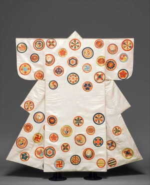 """A Noh Costume (Nuihaku) with Scattered Crests, Edo period, second half of the 18-19th century, from Japan, made of silk embroidery and gold leaf on silk satin. The kimono is included in the exhibition, """"Kimono: A Modern History,"""" on view at the Metropolitan Museum of Art through Jan. 19, 2015. (AP / The Metropolitan Museum of Art)"""