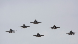 CF-18 Hornets fly in formation on their the departure for Operation IMPACT, in Cold Lake, Alberta on Tuesday, Oct. 21, 2014.  (Jason Franson / THE CANADIAN PRESS)