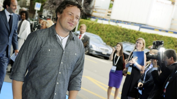 Jamie Oliver arrives for the opening ceremony of the One Young World summit in Zurich, Switzerland, Thursday, Sept. 1, 2011. (AP / Walter Bieri)