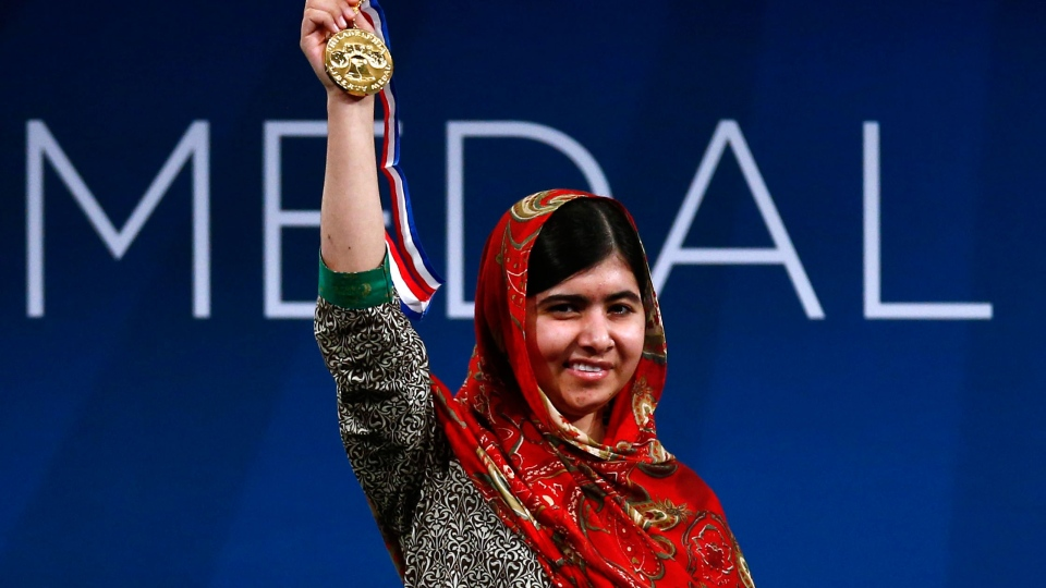 Malala Yousafzai holds up her Liberty Medal during a ceremony at the National Constitution Center in Philadelphia in Tuesday, Oct. 21, 2014. (AP / Matt Rourke)