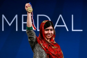 Malala Yousafzai holds up her Liberty Medal during a ceremony at the National Constitution Center, Tuesday, Oct. 21, 2014, in Philadelphia. (AP / Matt Rourke)