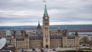 Centre Block on Parliament Hill in Ottawa is surrounded by police vehicles on on Wednesday, Oct. 22, 2014. (THE CANADIAN PRESS / Justin Tang)