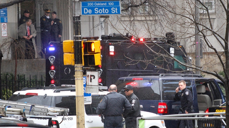 Police gather on DeSoto street near the front entrance to the Western Psychiatric Institute and Clinic on the University of Pittsburgh campus in Pittsburgh, Thursday, March 8, 2012. (AP / Keith Srakocic)