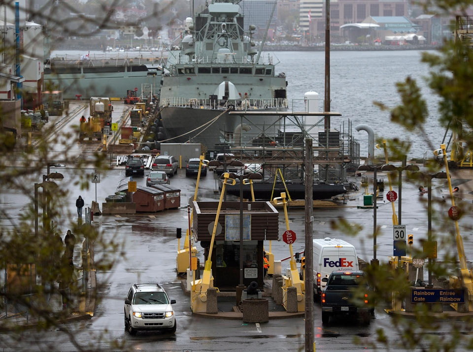 Vehicles enter Canadian Forces Base Halifax on Wednesday, October 22, 2014. Canadian military bases have heightened security measures after shootings in Ottawa. (Andrew Vaughan / THE CANADIAN PRESS)