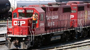 Canadian Pacific Railway locomotives move freight in Calgary on May 16, 2012 (Jeff McIntosh / The Canadian Press)