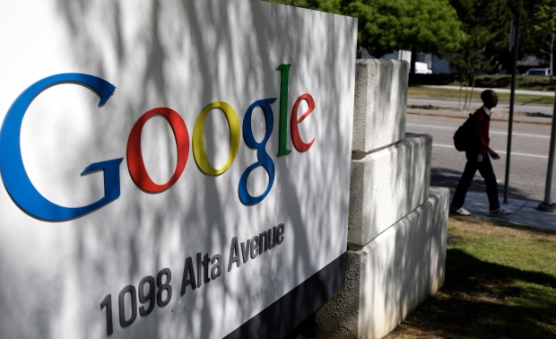 A man walks past a Google sign at the company's headquarters in Mountain View, Calif. on June 5, 2014 (AP / Marcio Jose Sanchez)