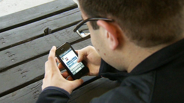 A man is seen with a smartphone.
