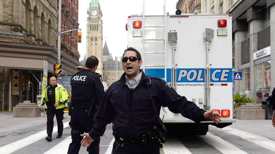 Police secure an area around Parliament Hill in Ottawa on Wednesday, Oct. 22, 2014. (Adrian Wyld / HE CANADIAN PRESS)