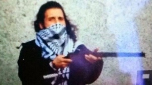 This is a reported photo of the suspect from Wednesday's attack in Ottawa, Michael Zehaf-Bibeau, from an ISIS Twitter account which has been suspended.