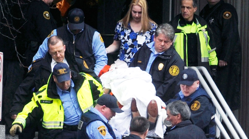 Paramedics and police carry a shooting victim from Western Psychiatric Institute and Clinic in Pittsburgh, Thursday, March 8, 2012. (AP / Pittsburgh Tribune-Review, Justin Merriman)