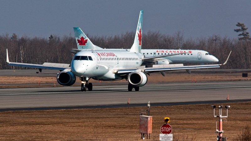 Two Air Canada jets taxi at Halifax Stanfield International Airport in Enfield, N.S. on Thursday, March 8, 2012. (Andrew Vaughan / THE CANADIAN PRESS)