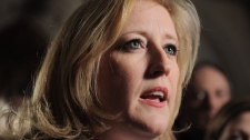 Minister of Labour Lisa Raitt speaks to reporters in the foyer of the House of Commons on Parliament Hill in Ottawa on Thursday, March 8, 2012. (Sean Kilpatrick /  THE CANADIAN PRESS)