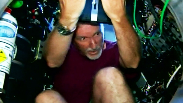 James Cameron enters the submersible craft he plans to take down seven miles to the world's deepest point, in the Mariana Trench of the Pacific Ocean, 200 miles southwest of Guam.