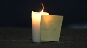 A candle and note with the name of slain reservist Nathan Cirillo of Hamilton, Ont., shown on the curb of a road near the National War Memorial in Ottawa on Wednesday, Octobe 22, 2014. THE CANADIAN PRESS/Sean Kilpatrick
