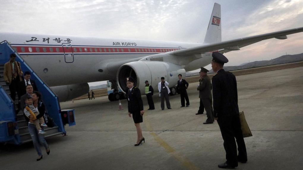 Disembarking an Air Koryo flight in Pyongyang