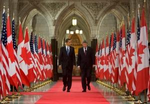 U.S.President Barack Obama and Prime Minister Stephen Harper walk down the Hall of Honour on Parliament Hill in Ottawa, Thursday Feb.19, 2009. (THE CANADIAN PRESS / Tom Hanson)