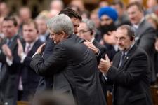 Harper and Trudeau hug in Parliament