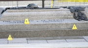 Evidence markers dot the Tomb of the Unknown Soldier at the National War Memorial in Ottawa on Thursday, Oct. 23, 2014. (Adrian Wyld / THE CANADIAN PRESS)