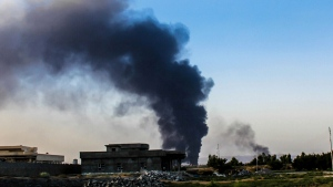 A column of smoke rises from an oil refinery in Beiji, some 250 kilometers north of Baghdad, Iraq, after an attack by Islamic militants, Thursday, July 31, 2014. (AP Photo)