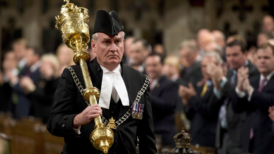 The Sergeant-at-Arms Kevin Vickers receives a standing ovation as he enters the House of Commons, in Ottawa, Thursday, Oct. 23, 2014. (Adrian Wyld / THE CANADIAN PRESS)