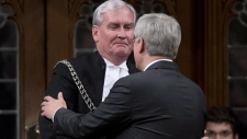 Harper speaks with Kevin Vickers in Ottawa