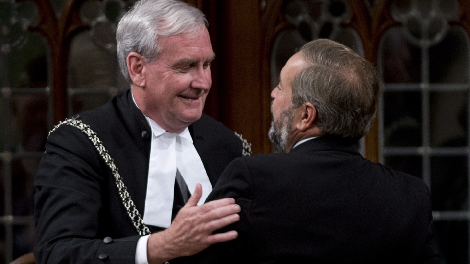 NDP leader Tom Mulcair speaks with the House of Commons Sergeant-at-Arms Kevin Vickers after making a statement in the House of Commons, in Ottawa, Thursday, Oct., 23, 2014. (Adrian Wyld / THE CANADIAN PRESS)