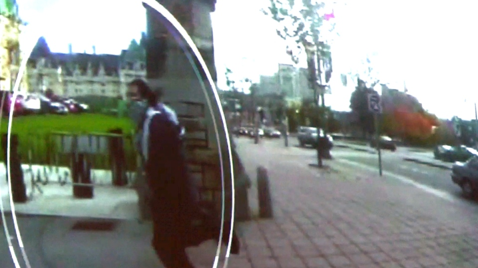 Michael Zehaf-Bibeau is shown carrying a gun while running towards Parliament Hill in Ottawa on Wednesday, Oct. 22, 2014, in a still taken from RCMP video surveillance.