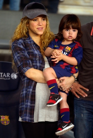 In this Oct. 18, 2014 photo Shakira holds her son Milan prior to the Spanish La Liga soccer match between FC Barcelona and Eibar at the Camp Nou stadium against Eibar in Barcelona, Spain.(AP Photo/Manu Fernandez)