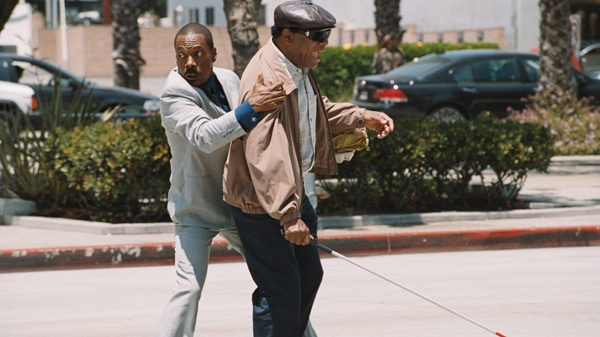 Eddie Murphy, left, and John Witherspoon are shown in a scene from Paramount's 'A Thousand Words.'