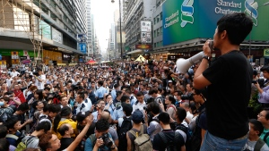 Pro-democracy protesters and their critics in the Mong Kok district of Hong Kong, on Oct. 24, 2014. (AP / Kin Cheung)