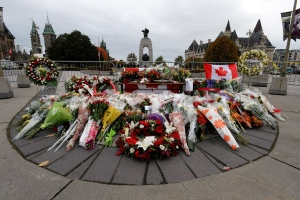 Floral tributes to Cpl. Nathan Cirillo sit at the National War Memorial in Ottawa, Ontario on Thursday, Oct. 23, 2014. (Sean Kilpatrick/THE CANADIAN PRESS)