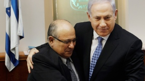 Israeli Prime Minister Benjamin Netanyahu, right, hugs Meir Dagan, then outgoing Mossad chief, after thanking him at the beginning of the weekly cabinet meeting in Jerusalem, Jan. 2, 2011. (AP / Ronen Zvulun, Pool, File)