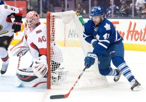 Toronto Maple Leafs forward Nazem Kadri, right, attempts a wraparound shot against Ottawa Senators goalie Robin Lehner during pre-season NHL hockey action in Toronto on Wednesday, September 24, 2014. (Nathan Denette / THE CANADIAN PRESS)