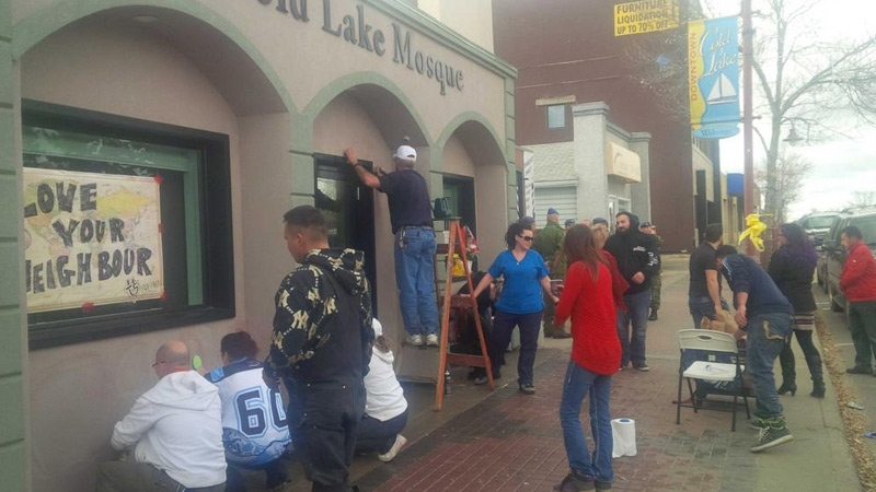 Cold Lake residents worked together to clean up the exterior walls of a mosque vandalized overnight in that city on Friday, October 24.