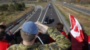 A Canadian soldier salutes the hearse carrying the body of Cpl. Nathan Cirillo on the Veterans Memorial Highway in Ottawa on Friday, Oct. 24, 2014. (Patrick Doyle / THE CANADIAN PRESS)