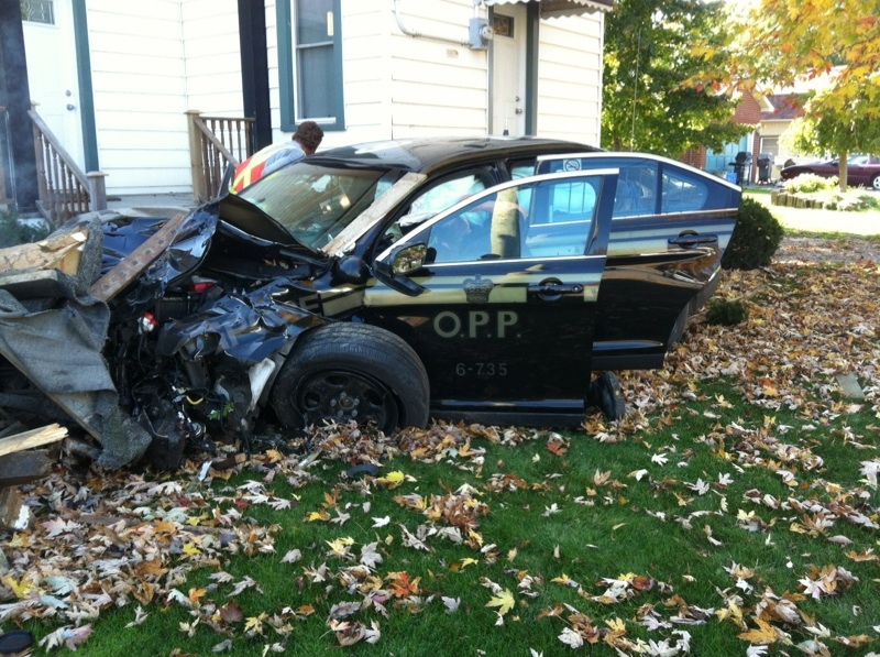 An OPP cruiser sits severely damaged in St. Joachim, Ont. after being involved in a collision on Friday, Oct. 24, 2014. (Viewer photo)