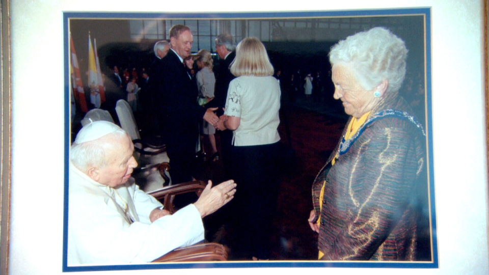 A photo in Mississauga Mayor Hazel McCallion's office of the mayor receiving Pope John Paul II at Pearson International Airport, as then-prime minister Jean Chretien looks on.