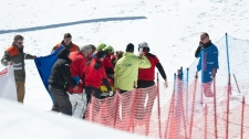 Staff members and medical assistants try to reanimate Canada's Nick Zoricic after he crashed during the skicross world cup finals, Saturday March 10, 2012 in Grindelwald, Switzerland. (AP Photo/Keystone/Samuel Truempy)