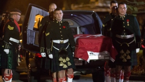 The body of Cpl Nathan Cirillo is carried by his fellow soldiers into the Markey-Dermody Funeral Home in Hamilton, Ontario on Friday, Oct. 24, 2014. (Peter Power / THE CANADIAN PRESS)