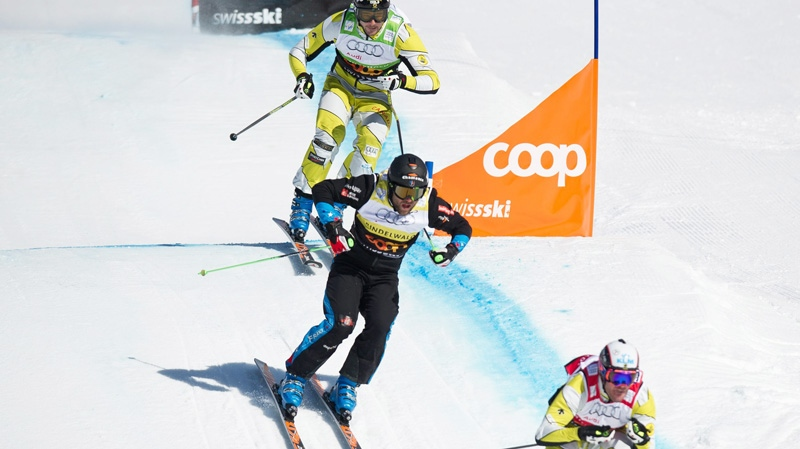 Canada's Christopher Delbosco, France's Jonas Devouassouk and Canada's Nick Zoricic, from right, speed down during the skicross world cup finals, Saturday March 10, 2012 in Grindelwald, Switzerland.