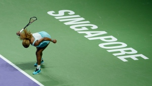 In this photo released by the World Sport Group, Serena Williams of the U.S. smashes her racket in frustration during her semifinal match against Denmark's Caroline Wozniacki at the WTA tennis finals in Singapore, Saturday, Oct. 25, 2014. (AP / World Sport Group, Paul Lakatos)