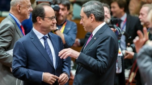 French President Francois Hollande, left, speaks with European Central Bank Governor Mario Draghi, right, during a round table meeting at an EU summit in Brussels on Friday, Oct. 24, 2014. (AP / Geert Vanden Wijngaert)
