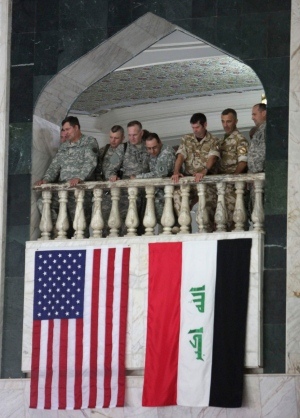 In this file photo, the U.S., left, and the Iraqi flag, right, are seen in Baghdad on Wednesday, Sept. 1, 2010.(AP / Hadi Mizban)