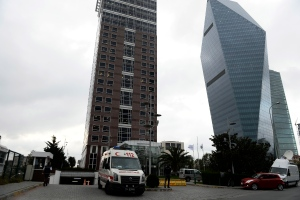 An ambulance waits outside a building, left, where the Canadian consulate is located in Istanbul, Turkey, Friday, Oct. 24, 2014. (AP / Emrah Gurel)