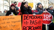 Demonstrators gather to protest the 'Robocall' election fraud scandal in Montreal, Sunday, March 11, 2012. (Graham Hughes / THE CANADIAN PRESS)