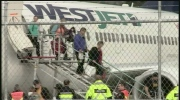 Extended: Passengers exit grounded WestJet flight