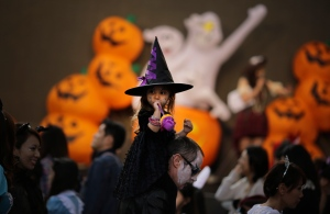 People in disguise participate in a Halloween costume festival in Tokyo on Saturday, Oct. 25, 2014. (AP / Eugene Hoshiko)